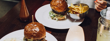 Tasty burger set on wooden table