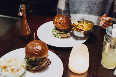 Tasty burger set on wooden table