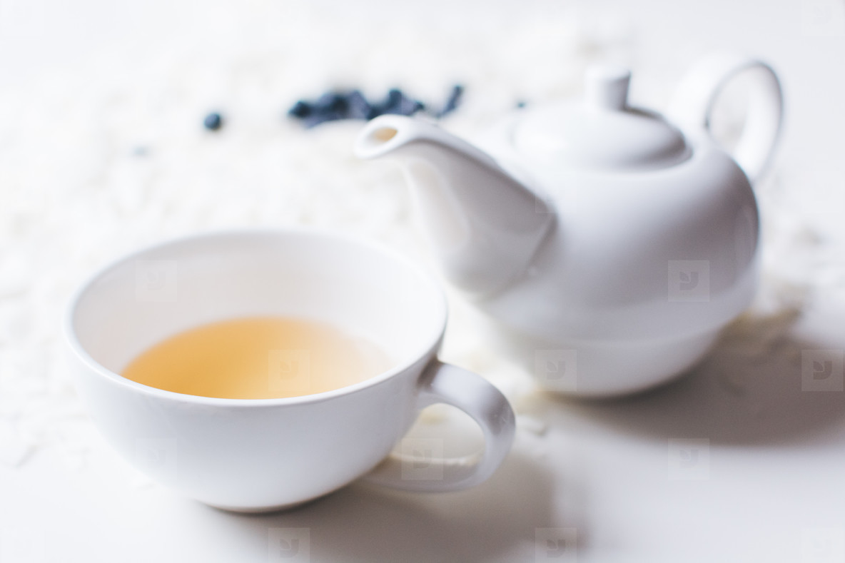 White a cup of tea with a teapot