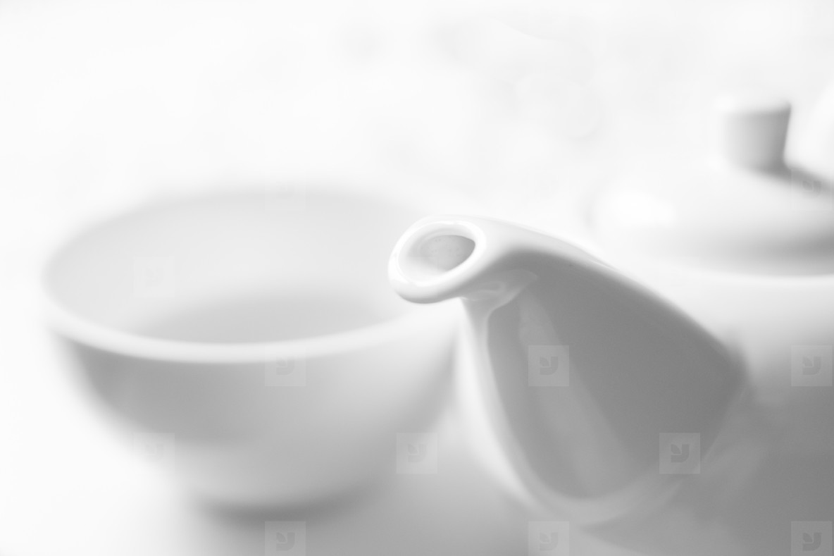 White a cup with teapot