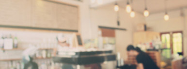 Barista at cafe blur background