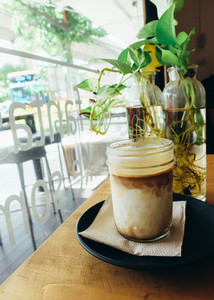 Iced coffee in hipster cafe