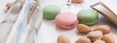 Colorful macarons and almonds