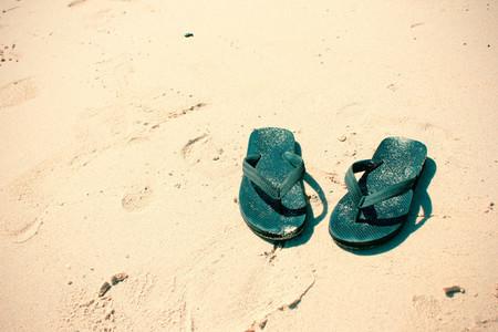 Flip flops on a sand ocean beach