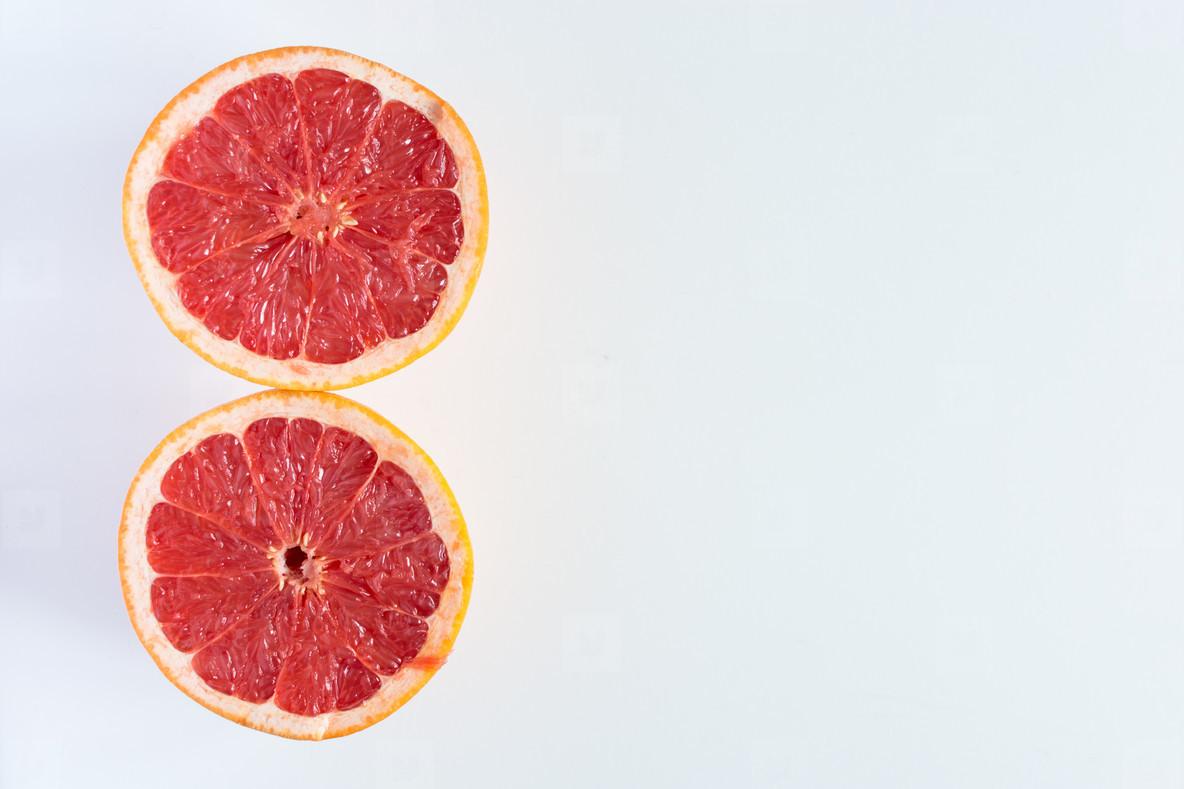 Two sliced halves Red Grapefruit