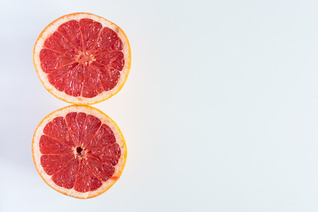 Two sliced halves Red Grapefruit