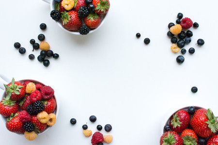Different berries in cups