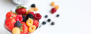 Closeup Berries in cups on white