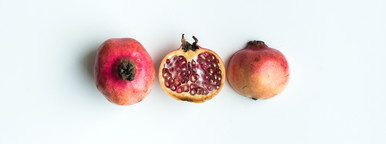 Ripe pomegranate with half