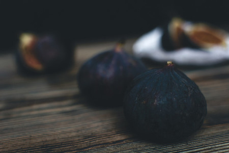 Figs fruits isolated on wooden