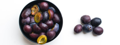 Black grapes on bowl  over the w