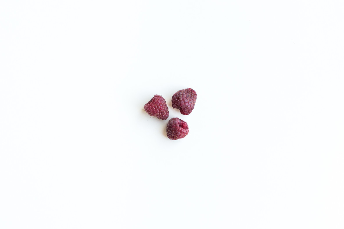 Rasberries on a white background