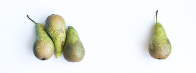 Four green pears isolated