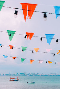 Colorful bunting flags with sea