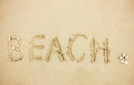 word beach on sand