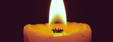 Burning candles on black