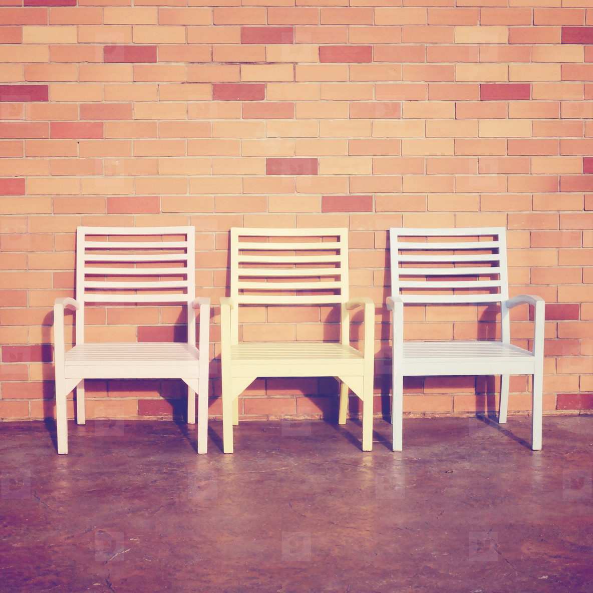chairs with brick wall