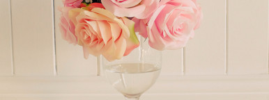 Bunch of rose in glass