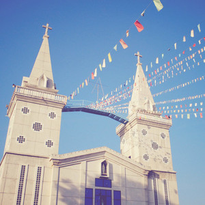 Colorful flags with a church