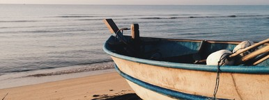 Blue Rowing Boat on the beach