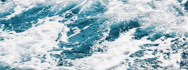 Texture of sea waves rocks surf