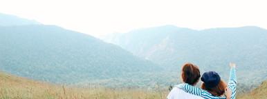 Couple overlooking autumn valley
