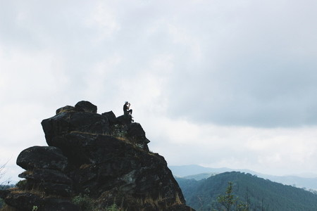 Young girl sitting on the peak