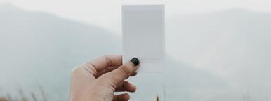 Hand holding polaroid