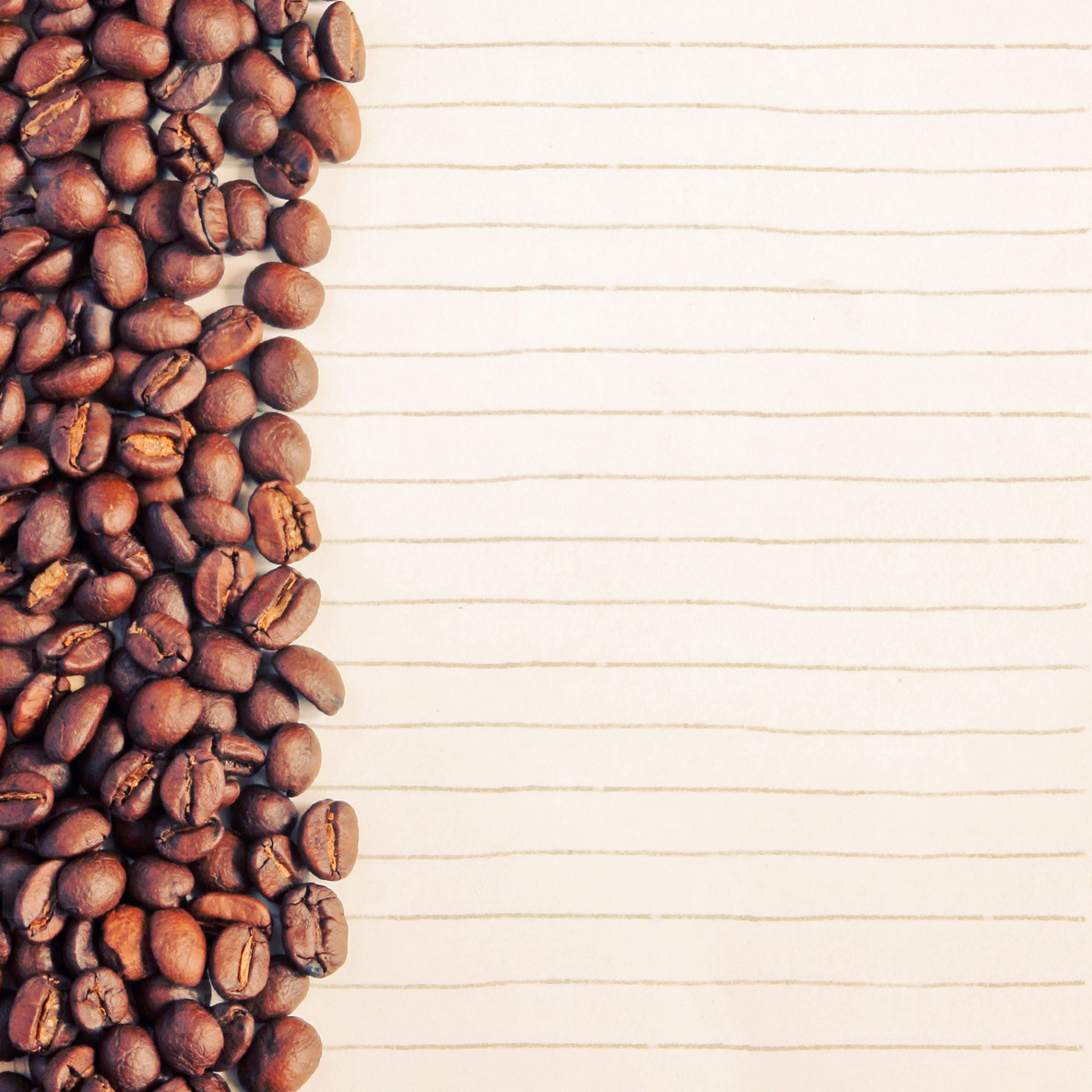 Coffee beans and paper