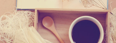 coffee and spoon on wooden tray