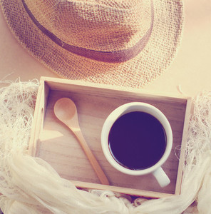 Straw hat with black coffee