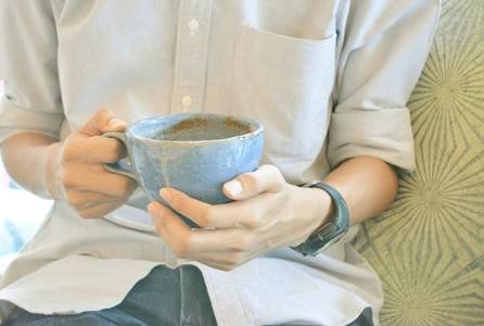 Blue Cup of coffee in hands