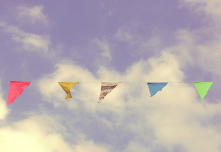 Colorful bunting flags on sky