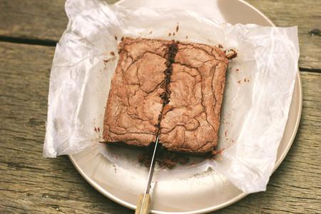cutting crispy homemade brownie