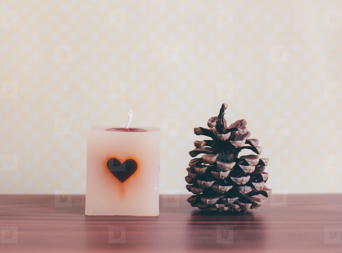 candle and pine cone
