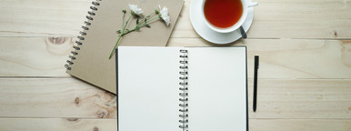 cup of tea and opened notebook