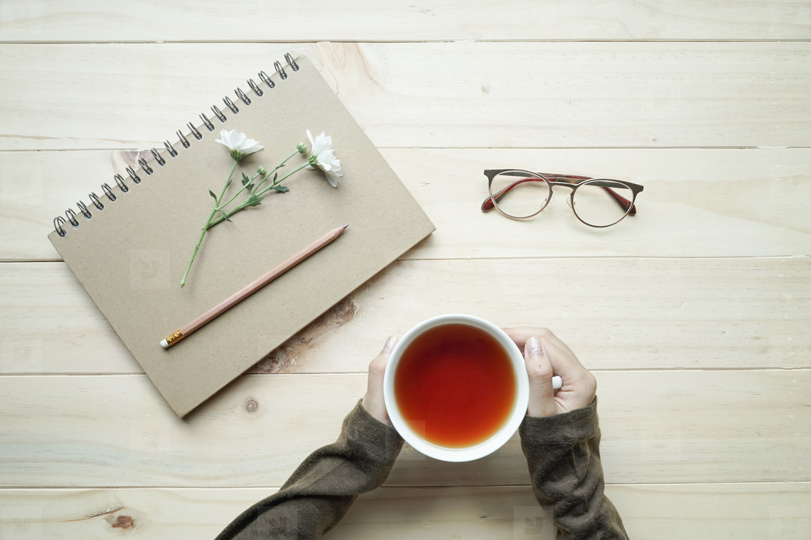 cup of tea and  notebook