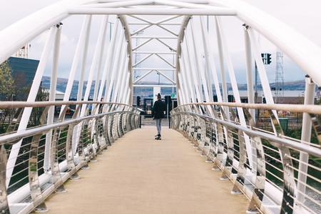 Skateboarder on Bridge