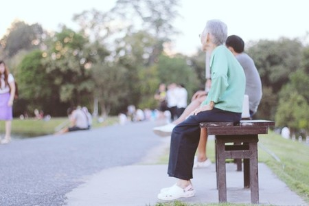 Grandparent seated on a bench