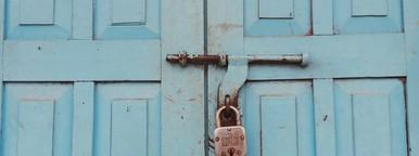 Lock on blue wooden door