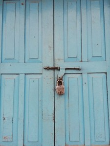 Lock on blue wooden door