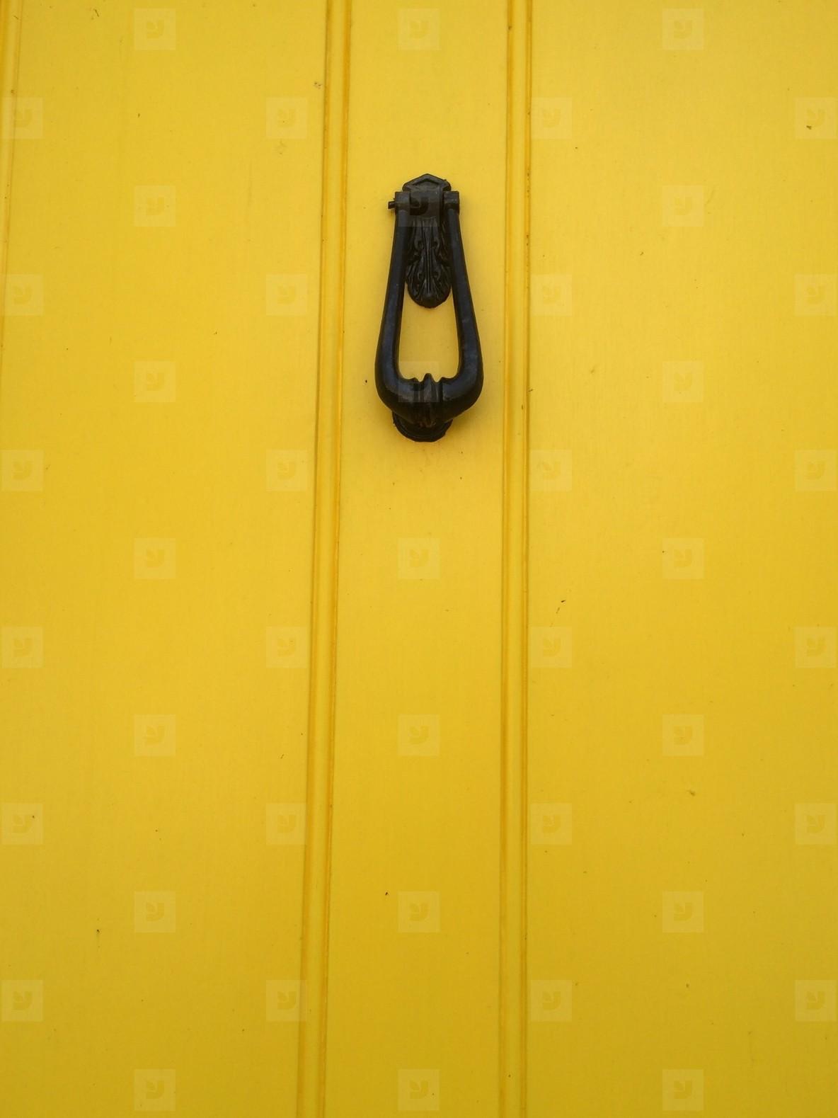 Knock on Yellow wooden door