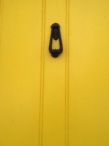 Knock on Yellow wooden door