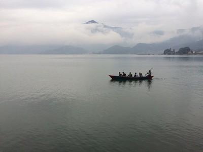 Oarsmans on lake background