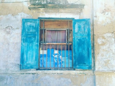 Old wooden blue window