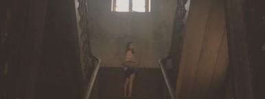 Girl standing on wooden ladder