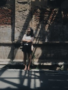 Girl standing in front of a wall