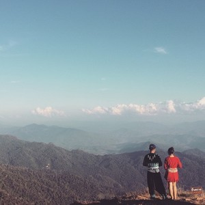 Couple standing on the peak