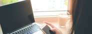 using smart phone and laptop