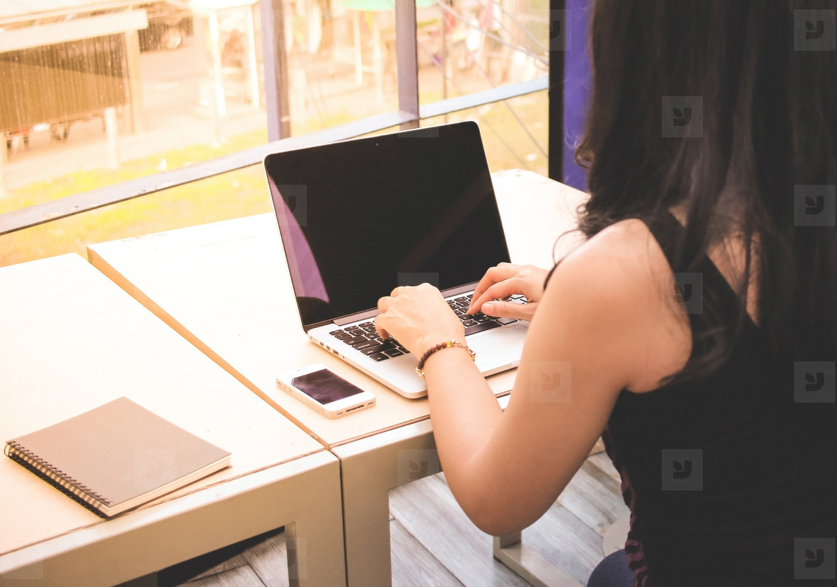 Woman typing keyboard of laptop